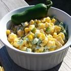 Mexican Corn   2 (15.25 ounce) cans whole kernel corn, drained  1 (8 ounce) package cream cheese  1/4 cup butter  10 jalapeno peppers, chopped  1 teaspoon garlic salt