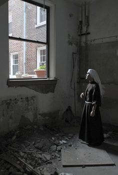 Sister Alicia Torres stands in a gutted downstairs kitchen at Our Lady of the Angels Roman Catholic Church. (Tribune photo by Antonio Perez/October 5, 2011 )