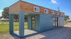 It's a tiny house...It's a shipping container...It's your favorite micro-home trends mashed up into one! This 312-square-foot abode is a brand spanking new tiny house converted from a shipping container, with about a third of it carved out to form a covered porch.