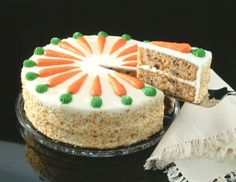 Carrot Cake: Don`t let the long list of ingredients scare you! This is truly easy to make with pre-shredded organic carrots and lots of on-hand spices most of us keep in our cupboards.