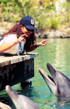 Janet Jackson entertaining a pair of dolphins