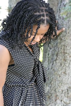 Twists. To learn how to grow your hair longer click here - http://blackhair.cc/1jSY2ux