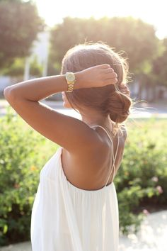 loose, chic sundress + gold watch + easy breezy low chignon