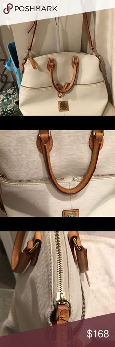 🌻 NWOT ✨ Dooney & Bourke Shoulder Bag ✨ 🌻 NWOT Dooney & Bourke ✨ A Beautiful Bag that I hate to give up but I need some room in my closet ✨ you can carry as Crossbody or just with the handles ✨ front has two zip pockets main compartment also closes with a zipper ✨ inside has slip pockets with snap, key fob and zip pocket ✨ the only area of concern is the bottom has a flaw there's a looks to be a scratch ✨ Otherwise Gorgeous 🌻✨✨✨ Dooney & Bourke Bags Satchels