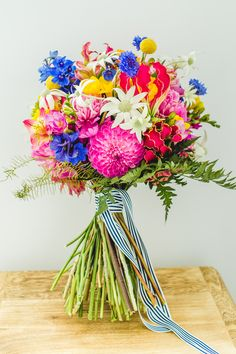 Bright summer wedding bouquet | Curly Tree Photography | See more: http://theweddingplaybook.com/bold-bright-floral-wedding/