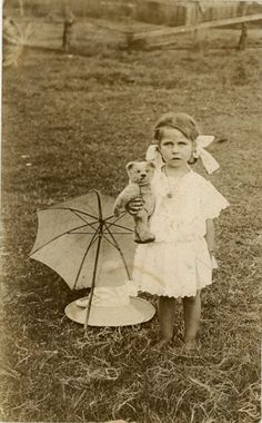 little girl with parasol and teddy bear