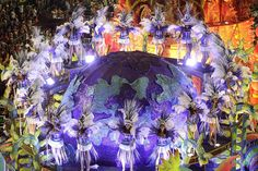 Performers from the Unidos de Vila Isabel samba school parade during Carnival celebrations at the Sambadrome in Rio de Janeiro.  1 / 30  HIDE CAPTIONS  SHOW THUMBNAILS  LEAVE COMMENT  PHOTOGRAPH BY: HASSAN AMMAR / ASSOCIATED PRESS