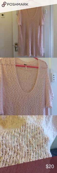 Free People Sweater Dress pInk sweater dress. Long goes past my knees a little. I'm 5'5 great condition. Size large runs oversized. Some larger holes shown in photos in the back. Not noticeable. The material is hokey throughout. Sweaters Shrugs & Ponchos