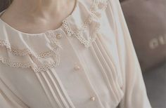 lace collar, pearl buttons, pleats, silk