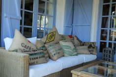 Sofa de una casa en Alella, Barcelona. con cojines hechos con sacos de café reciclados. / Terrace in Barcelona, with coffee grain sack cushions, by WIKI PILLOW. See more details in the Blog. http://www.wikipillow.com/blog/14134726