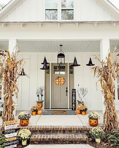 fall front porch, halloween decor, front porch, spooky Old Time Pottery has the perfect spooky décor. These jack-o-lantern planters are my favorite. If you aren't into Halloween you can turn them around for a pretty pumpkin planter.