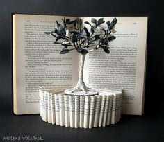 Paper sculpture from a book. Click on the link to see different designs!