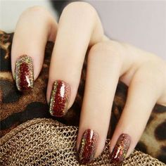 Nail Art. Burgundy topped with a dust of Gold