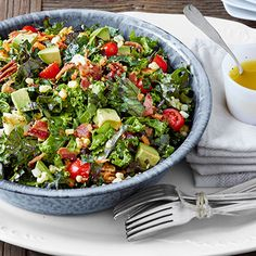 Chopped Collard and Kale Salad with Lemon-Garlic Dressing - This salad has it all: tomatoes, pecans, bacon, and more top a hearty bed of kale and collards. #myplate #vegetables