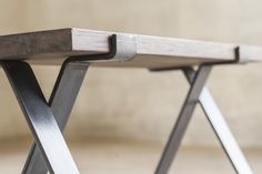 "Bold MFG is proud to offer our Cross Legs from the Flatform series. This pair of bench legs is cold formed from 3/8"" x 3"" flat bar steel and receives a oiled finish that is well suited for indoor use."