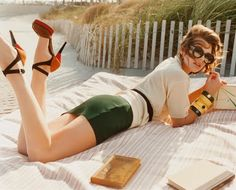 Sort of wish I was her. I mean. Beach. Book. Nice big blanket. Awesome heels... How could it b better?