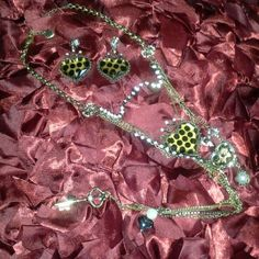 SALE - Betsey Johnson set NWOT Has been sitting in my jewlery box, never worn : (  Gold metal with heart shapes, black polka dots, diamond accents, and pearl accents. Very detailed. Earrings are approx 2 inches (and have weight to them).  Necklace is approx 19 inches .  ** Willing to bundle this set and the blue Betsy flower necklace for $30** Betsey Johnson Jewelry Necklaces