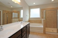 Natural light graciously brightens up this lovely Saluda master bathroom! Double vanity sinks, walk in shower and garden tub—a perfect master retreat!