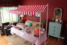 DIY Lemonade stand awning made from PVC pipe and Ikea striped fabric Vacuuming in high heels