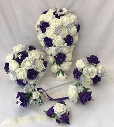 These bouquets are made with. All bouquets and wands have a silver butterfly. the wedding bouquets are. Satin headbands with matching design to bouquets & combs. Small child's bridesmaid 6 by 6 inc. Bride teardrop long by inc wide. Artificial Wedding Bouquets, Purple Wedding Bouquets, Bridesmaid Flowers, Beach Wedding Headpieces, Headpiece Wedding, Flower Girl Wand, Bridesmaid Headband, Crystal Bouquet, Foam Roses