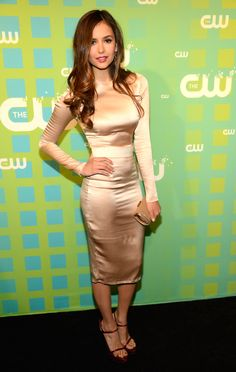 Nina Dobrev took to the CW Upfronts in an ultraelegant fitted sheath and Veronica Lake-inspired waves 2012