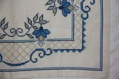 Beautiful blue cross stitch em |