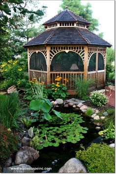 Gazebo surrounded by a terrific water feature.  In Birmingham, AL to keep your investment in your #landscape projects watered properly, get awesome service in Birmingham, AL www.BlueSkyRain.com #sprinklers and landscape lighting.
