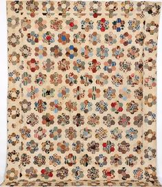 People's Collection Wales -A 19th century patchwork bedcover from Cardiff. Mostly made from cotton chintzes.
