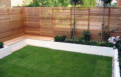 Built in seating, red cedar fencing in Putney garden
