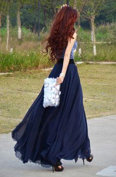 flowy maxi skirt, same color top, sparkly clutch, and curls