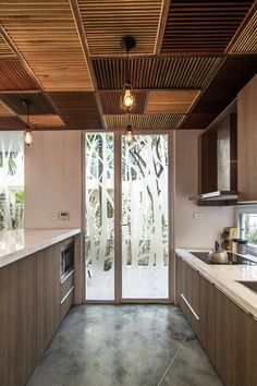 EPV House by AHL architects | Photo © Hoang Le wooden ceiling interior http://www.woodz.co/ecopark-green-urban-house/