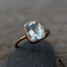 Aquamarine and rose gold ring from onegarnetgirl on Etsy.