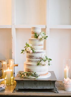 Rustic Wedding Cake with Summer Flowers and Modern Candles
