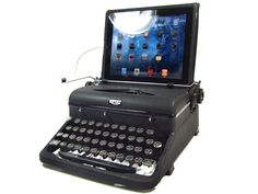 USB typewriter keyboard for your...iPad?! whaaaat?! I love what an oxymoron this gadget is, but FINALLY those of us Luddites who refuse to keep up with modern technology have an outlet to the past!!