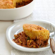 Chicken-Chili Tamale Pie | This chicken chili tamale pie recipe combines two Southern comfort foods in one dish: the spicy corn and chicken chili is topped with buttery and cheesy corn bread.