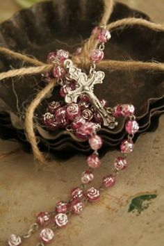 Vintage rosary with rose colored rose shaped beads