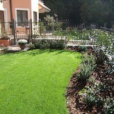 Jardines de estilo moderno de Mauro Morganti