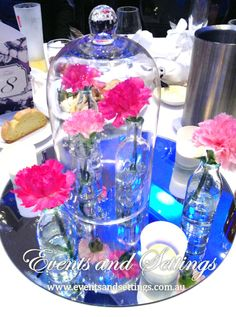 #beautyandthebeastcentrepiece #flowers #roses #carnations #wedding #modaportside #vintagebottles #glassdome #love