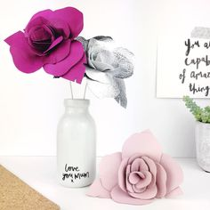 So Mother's Day is finally a go in the shop with 3 new cards & flowers galore & to celebrate me finally getting my bum in gear & also passing 500 sales in my @etsy shop I thought we'd have a little giveaway! To win everything pictured for your Mum - 3 leather roses in your choice of colours & a customised bottle to display them in - tag a friend below & tell me why your Mum is the bees knees & I'll pick a winner at random on Saturday morning... for an extra entry feel free to share the pic…