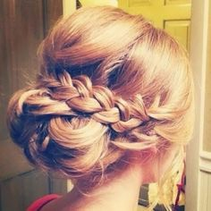 Updo that looks soft and incorporates a plait. Would look nice with a very sheer veil on top.