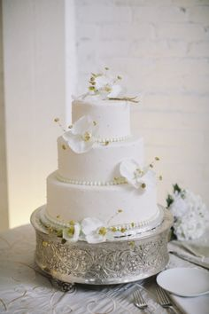 Classic Wedding Cake With White Orchids | photography by http://lovemedophotography.com/