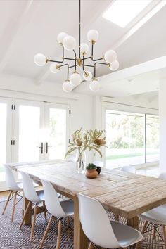 Light-filled white dining room featuring the Bistro Medium Chandelier by Ian K. Dining Room Design, Farmhouse Dining Room, Spanish Home Decor, Dining Room Inspiration, White Dining Room, Rustic Dining Room, Dining Room Lighting, Dinning Room Design, Modern Dining Room