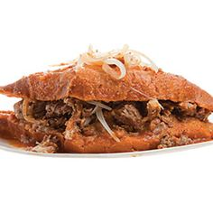 """Torta Ahogada (Mexican """"Drowned"""" Sandwich)   This popular Mexican sandwich from the state of Jalisco is filled with crisp roast pork, then """"drowned"""" in a spicy chile de árbol sauce."""