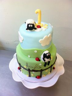 it says KAYLAAAA!!!!! Frickin' adorable kids' birthday cake with sheep on it. by emmacakes on flickr.