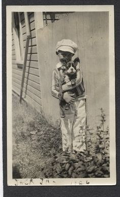 Boston Terrier and young boy, 1926