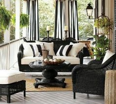 Patio/Porch Decor: Wicker Furniture = Yard Sale painted black  Curtains/ Cushions = DIY fabric store