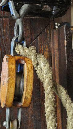 Industrial Urban Rustic Farmhouse Vintage Wood Pulley and Hook. $40.00, via Etsy.