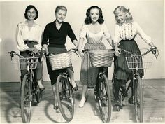 Jean Simmons, Joan Fontaine, Piper Laurie and Sandra Dee ride bikes. (And Sandra Dee tries not to lose her head.)