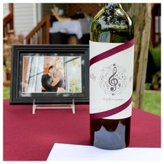 guests filled a wine bottle with wishes, advice and funny sayings at a wine themed bridal shower. to be opened on an anniversary.