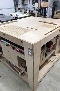 This table features a lot of what I wanted in an outfeed assembly table. Workbench Plans, Woodworking Workbench, Woodworking Workshop, Woodworking Projects, Garage Workbench, Woodworking Assembly Table, Woodworking Shop Layout, Fold Down Work Bench, Workshop Storage